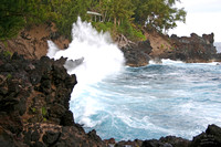 Wave crashes on to the rocks on the Big Island of Hawaii